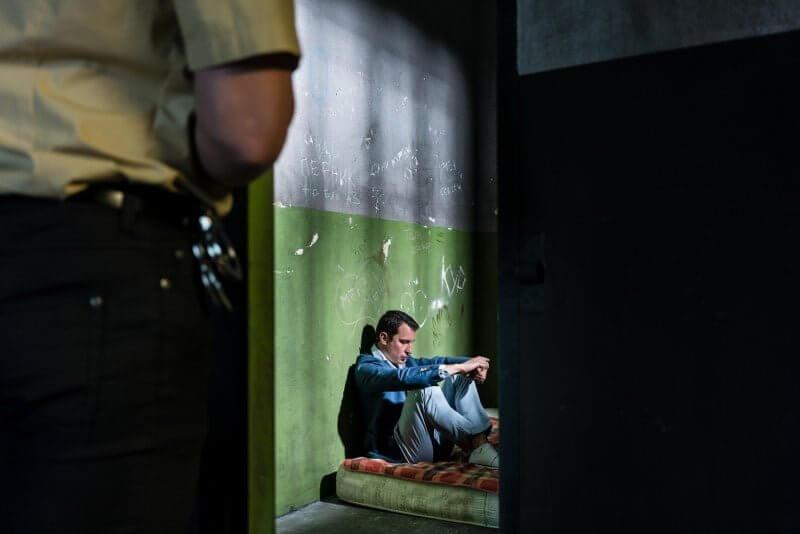 man in lockdown inside prison cell